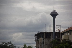 solitary__water_tower_over_chiang_mai_thailand_by_druinfly-d58mv37